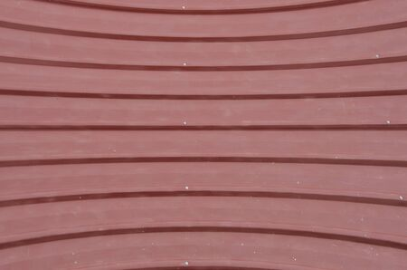 Red line pattern of metal sheet roof in light Imagens