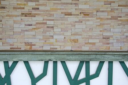 Art of sandstone block wall and green lath of counter Imagens