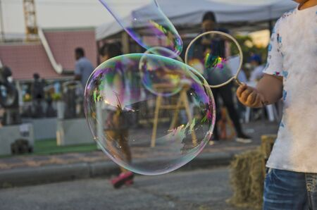 Beautiful air bubbles with child and making tool