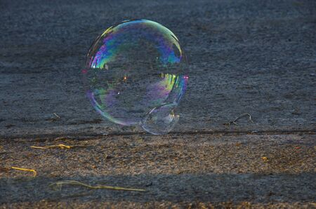 Beautiful colors of reflections on air bubble skin over concrete floor