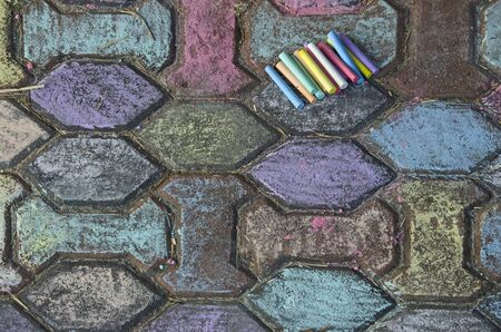 Colored street arts and chalks on block floor