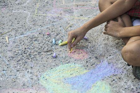 Street art workmanship of young artist on dirty floor