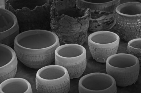Beautiful baked clay pots on table in light