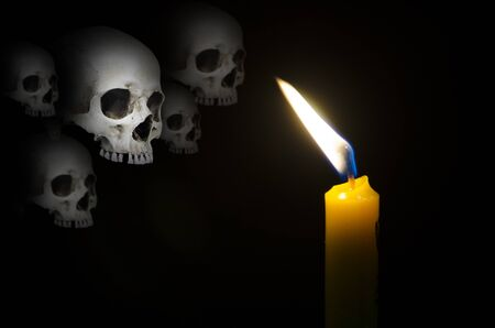 Haunted ghosts in candle light in scared dark night