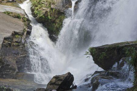 Beautiful white waterfall on rock cliff