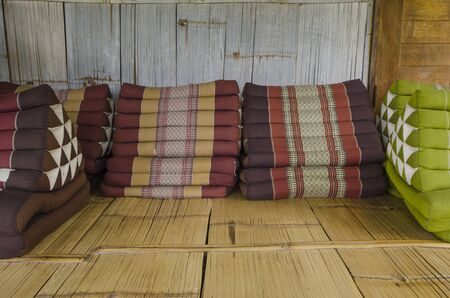 Beautiful resting pillows on bamboo floor and wall background