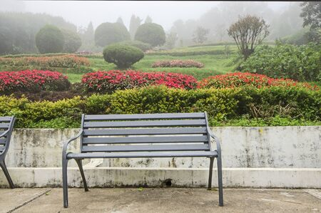 Empty iron seats with beautiful garden background