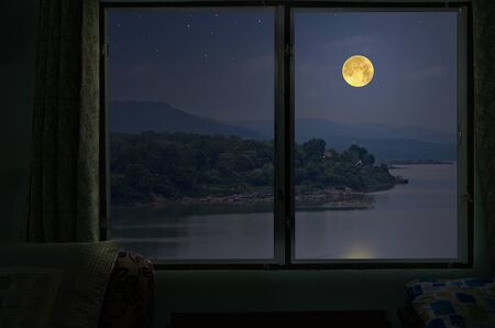 Beautiful full moon over the river from window view point