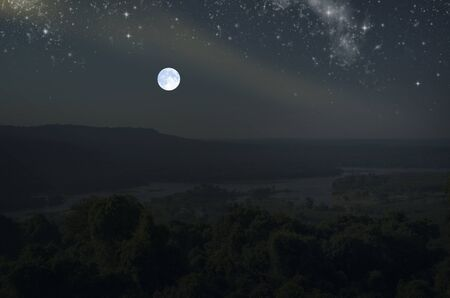 Bright full moon and stars over the mountains and river Stock Photo