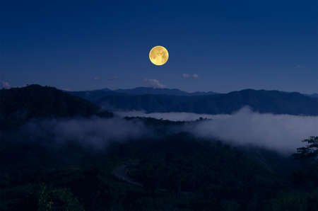 Bright full moon over the mountains in lonely night Imagens