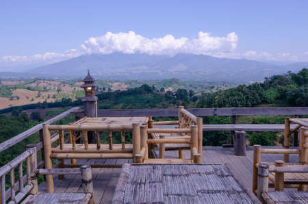 Bamboo tables and chairs on view point terrace with beautiful background Imagens