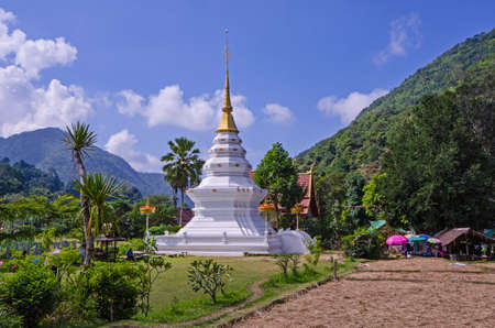 Beautiful white pagoda in the valley with blue sky background
