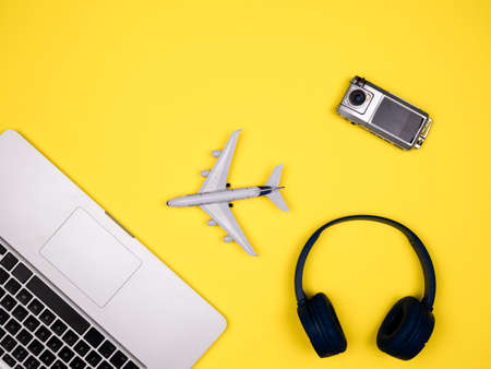 Travel concept displaying airplane, camera and headphones