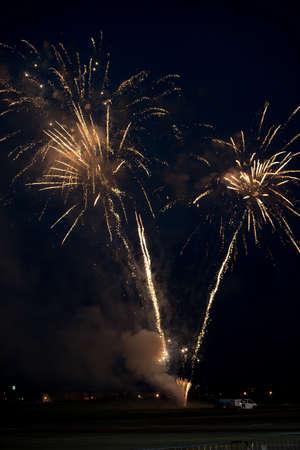 Multiple golden fireworks exploding in the sky Stock Photo