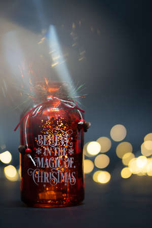 Motivational jar Believe in the magic of Christmas with golden bokeh lights