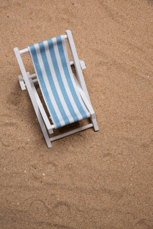 Sunbed laying on very fine sand in portrait flat lay with copy space in portrait mode Фото со стока