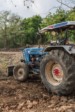 Parking tractor for agricultural machinery, seeding and sowing crops at field.