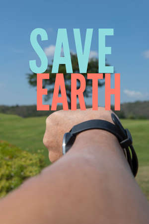 Save Earth awareness for global warming, generation Z reach hand to save a big tree in a park.