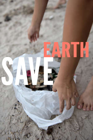 Beach clean up by volunteer on the Hua Hin beach, Thailand, during the summer time. Save Earth awareness on Earth day and every day.