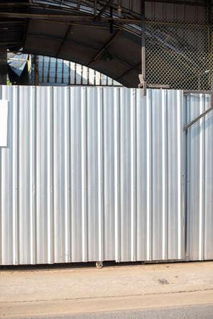 Aluminum Metal corrugated door sheet with black steel column structure.
