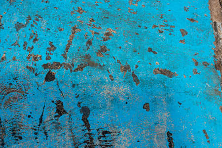 Fresh closeup turquoise color street texture, cropped only details showing rough painted and accidental patterns created by car wheels and weathers.