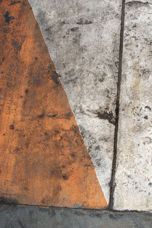 Fresh closeup orange, white and yellow color of street texture, cropped only details showing rough painted and accidental patterns created by car wheels and weathers. 写真素材