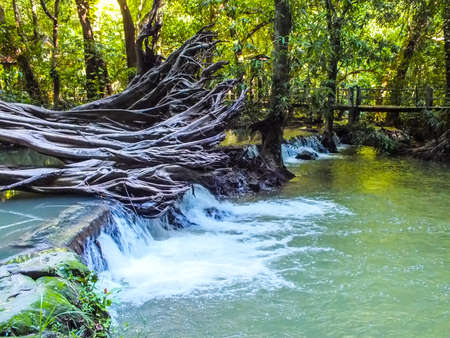 trough:  waterfall trough rock tourist attraction Krabi Thailandbeautiful island marine sea