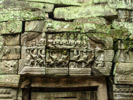 lintel: Cambodia Angkor Wat Khmer Asia tourist attraction pathway View Castle Rock archaeologicalsite door arch lintel Carvings 5 Stock Photo