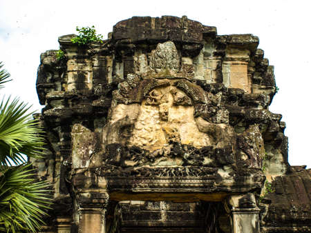 lintel: Cambodia Angkor Wat Khmer Asia tourist attraction pathway View Castle Rock archaeologicalsite door arch lintel Carvings 1 Stock Photo