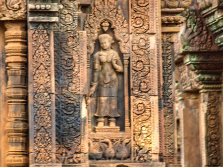 lintel: Cambodia Angkor Wat Khmer Asia tourist attraction pathway View Castle Rock archaeologicalsite door arch lintel Carvings goddess3 Stock Photo