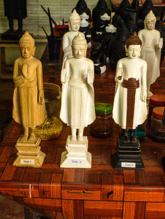 centers: Cambodia Angkor Wat Khmer Asia tourist attraction pathway View Craft Centre Crafts centers crafts priest Buddha statue Wood carving