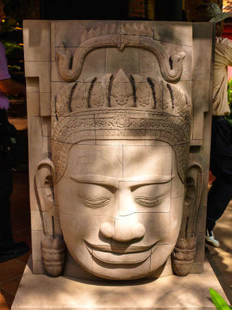 carver: Cambodia Angkor Wat Khmer Asia tourist attraction pathway View Craft Centre Crafts centers crafts Wood carving Carver head angel 2 Stock Photo