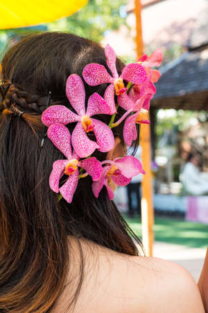 bedeck: The orchid decorate on womens head