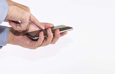 input devices: Mans hand holding a smartphone on white background