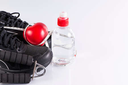 water shoes: Fitness background with bottle of water , shoes and heart