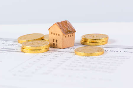 House and coin,  invesment and realestate concept Stock Photo