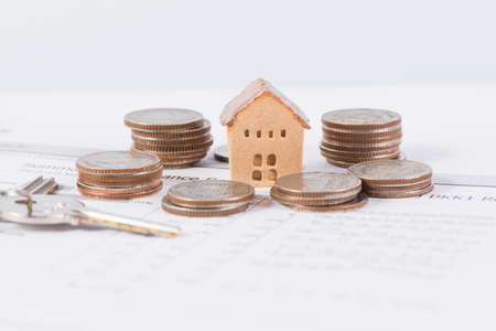 House and keyring, investment and real-estate concept