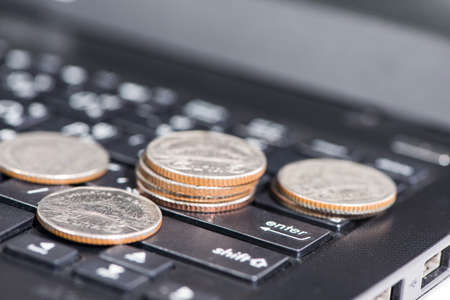 The group of coins on laptop, business concept Stock Photo