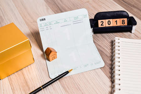 notebook: The empty book bank with 2018 new year cubes and home model , finance planning  concept