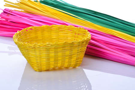 Yellow basket handmade made from bamboo with colorful bamboo line