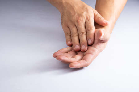 scrubbing hand by soap or cleasing oil on white acrylic sheet background