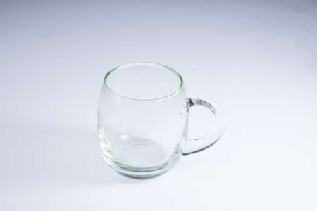 transparent mug on white acrylic sheet