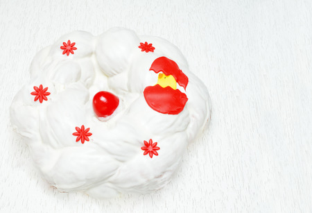 Greek Easter bread, tsoureki covered with cream cheese frosting