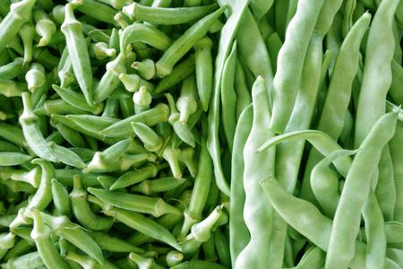 Fresh green okra and beans as background Banco de Imagens