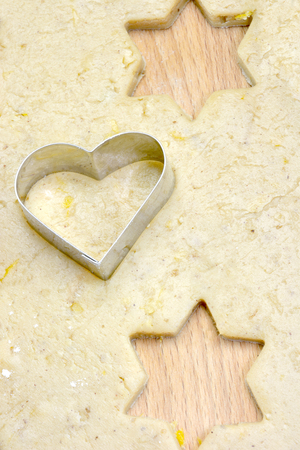 Heart biscuit cutter on dough