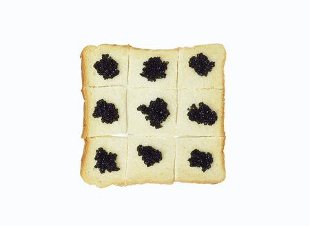 Black caviar on white bread isolated on white background Stock Photo