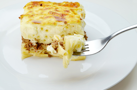 Delicious mouthful of pastitsio on  fork Stock Photo