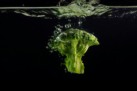Broccoli splash on black background 写真素材