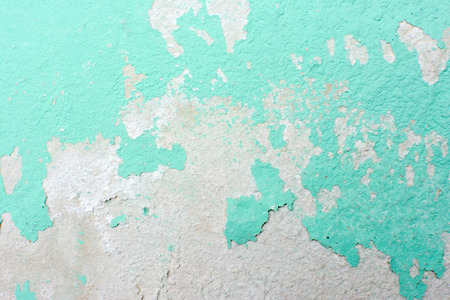 Background of turquoise green peeling paint