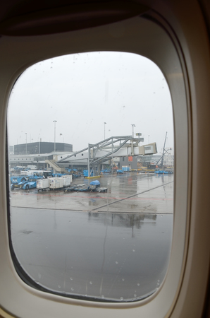 AIRPORT SCHIPHOL,AMSTERDAM ,NETHERLANDS, MAY 2014: Passenger boarding bridge at Amsterdam Airport Schiphol , view of airplane window Editorial